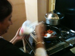 Rajishi finishing up her delicious tomato chutney. I'll upload better photos of the food next week!